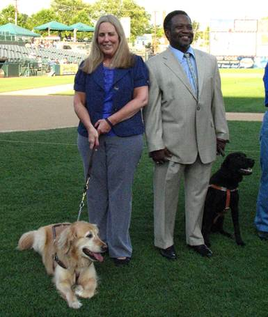 image of guide dog, Gretchen with owner Susan Vanino and Lucca with owner James Jasey